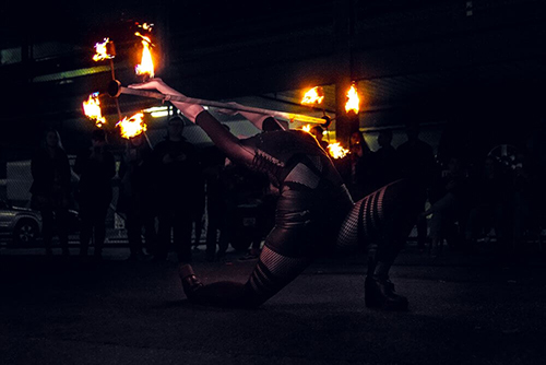 Nyx's Hot Dragonstaff Fire Entertainment at The Market Shed on Holland Fire Performance, Fire Dancing at Twilight market Suzanne Elliot Photography